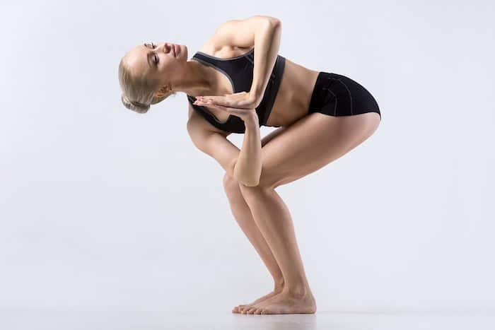 yoga standing pose chair twist